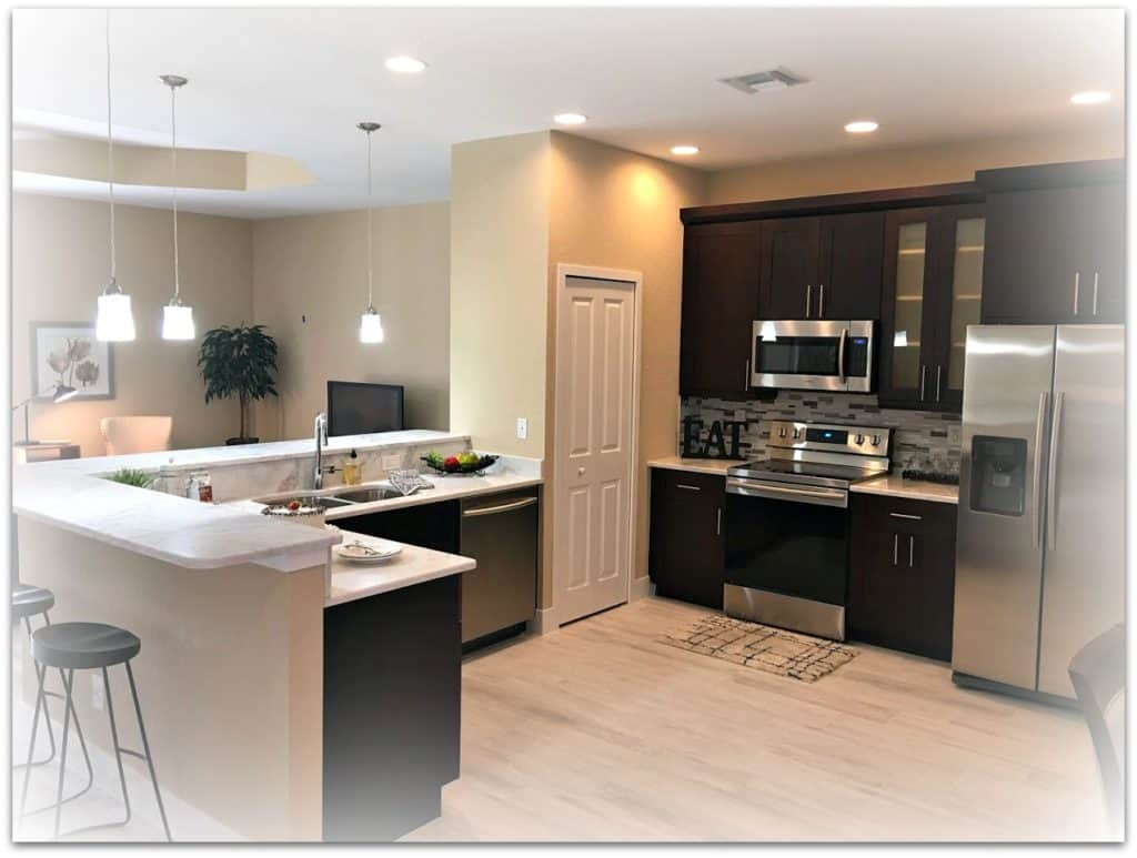 black kitchen cabinets and light granite counter tops